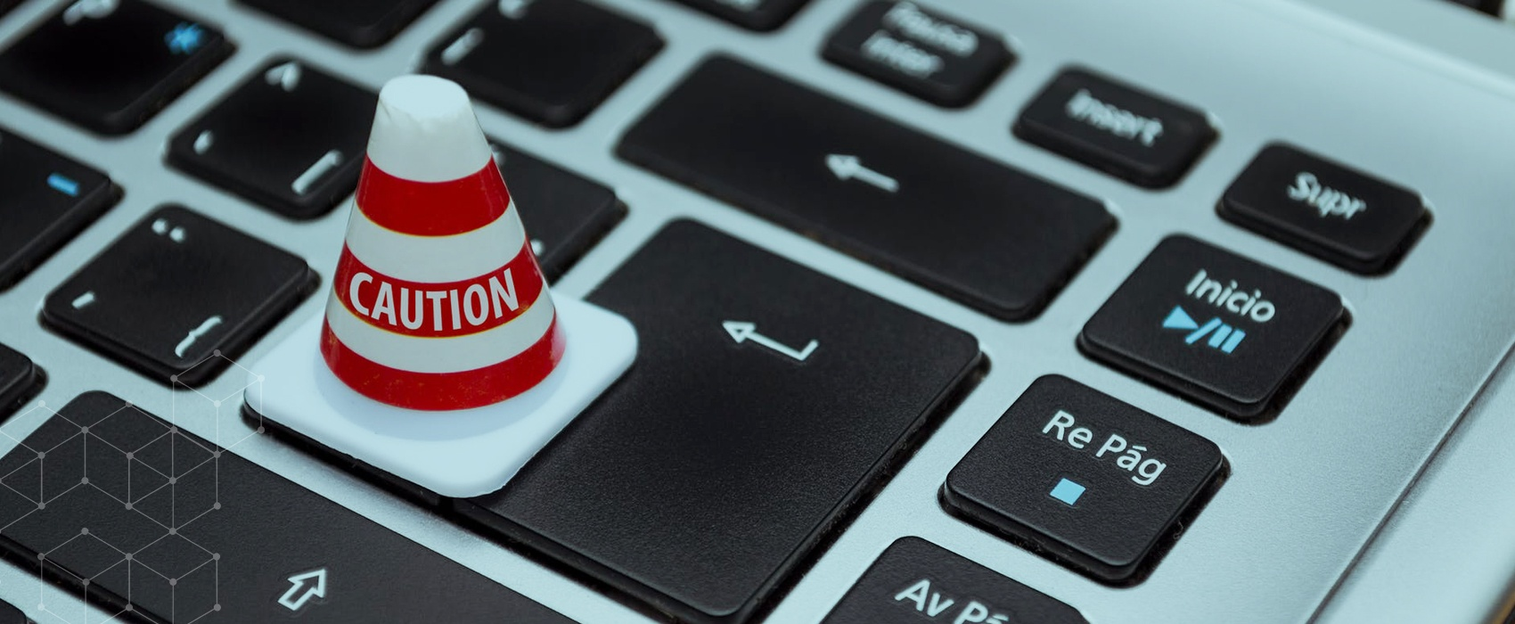 """Caution"" cone resting on keyboard"