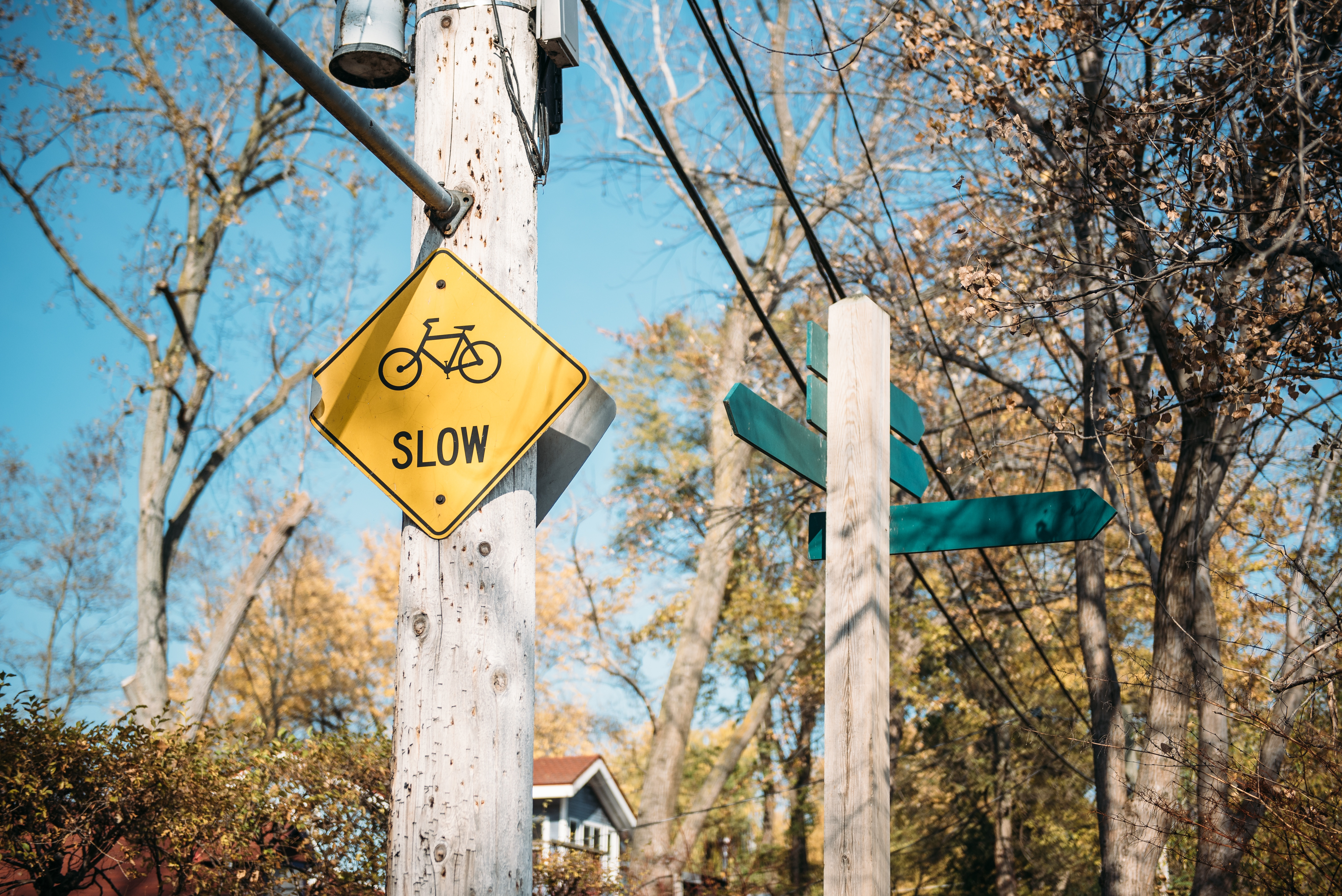 slow down street sign
